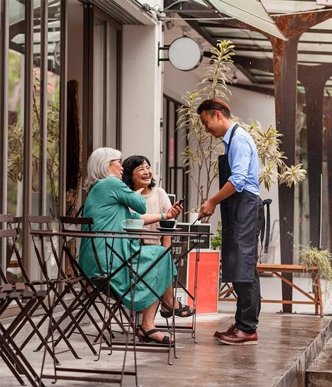 Elderly-Paying-Outside